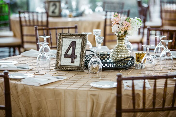 The reception tables were numbered with love letter paper in vintage gold picture frames completed with bronze numbers to complement the glamorous, vintage look of the reception.