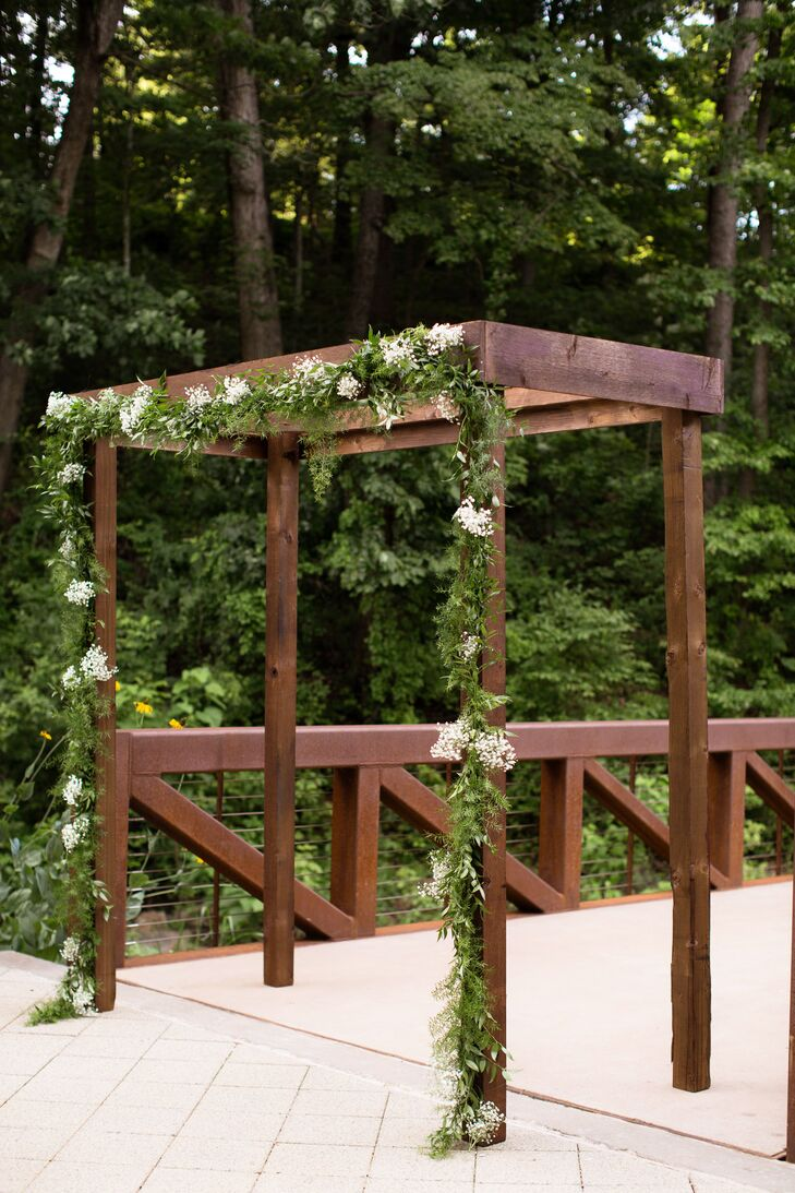 Baby S Breath And Garland Adorned Wedding Arch