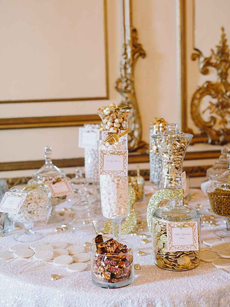 Glamorous white and gold wedding candy bar
