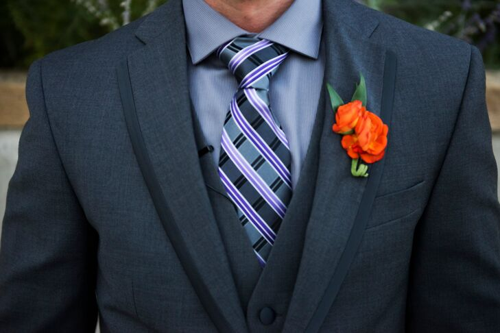 The groom and groomsmen wore three-piece gray suits with gray and purple patterned ties. They completed the look with orange rose bloom boutonnieres.