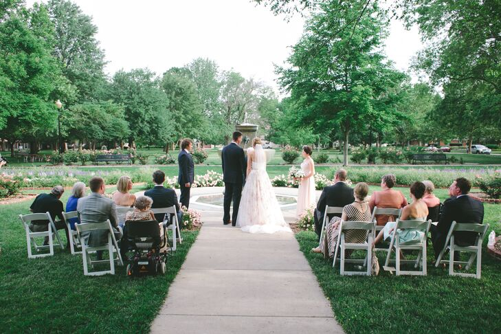 """The park was so beautiful,"" Meghan says of her natural wedding venue. ""All the trees and flowers were in bloom so I didn't think there was anything that would make it better than it already was."" Meghan and Camron exchanged vows at South Park in Lawrence, Kansas. Since they both grew up in the small town and loved the park, it was the perfect fit."