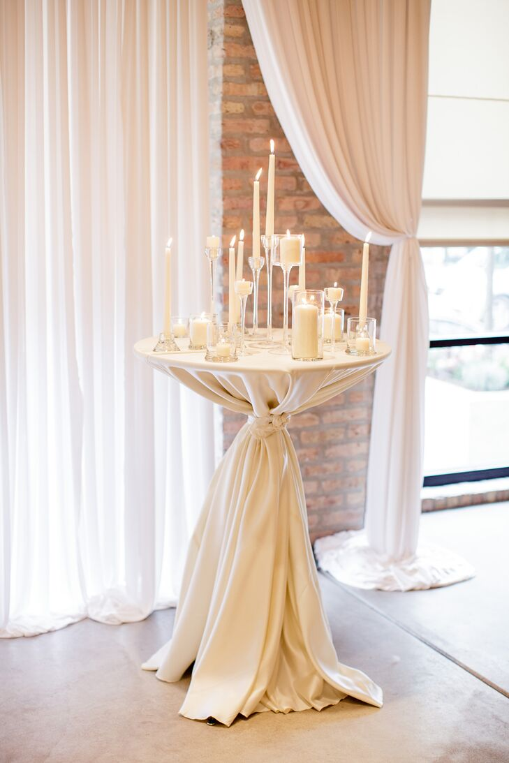 The floor-to-ceiling windows and giant wooden pillars at Centered Chef, in Chicago, Illinois, with tallboys filled with high and low candles, created a simply elegant and romantic atmosphere for Rachel and Adam's ceremony.