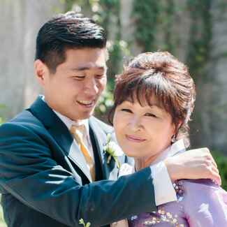 Groom hugging his mother on wedding day