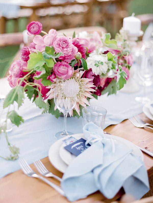 Protea flower wedding centerpieces bright pink protea and ranunculus centerpiece mightylinksfo