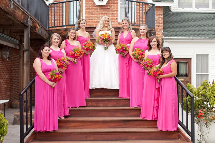 The bridesmaids wore floor-length pink dresses in whatever style they wanted.