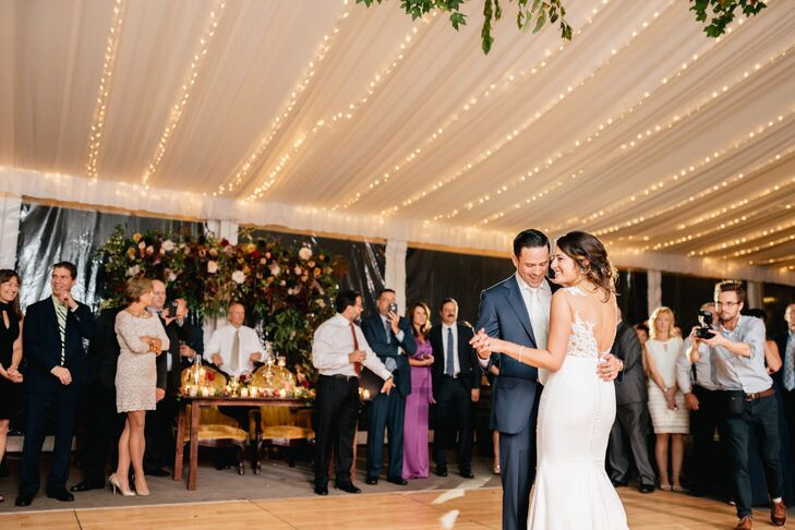 First Dance in Tented Reception Space Lined with Overhead Lighting