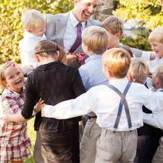 Kids and groom at the wedding reception