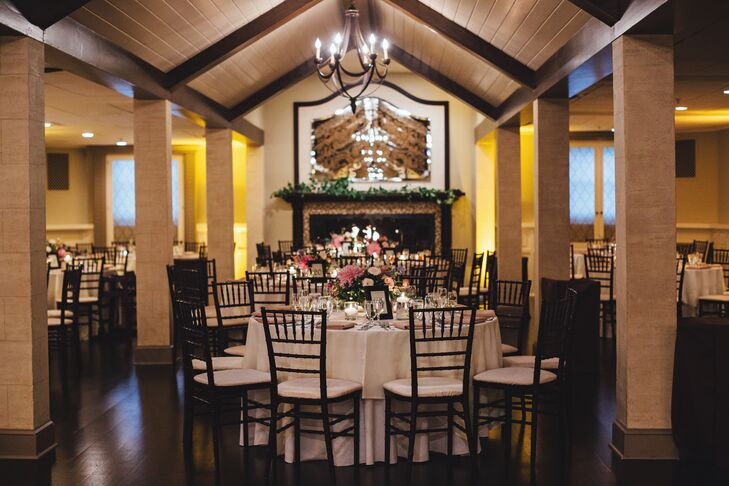 The Villa's Madera Ballroom provided a warm, intimate backdrop for the reception with its lofty, wood-paneled ceilings, amber uplighting and statement fireplace. To set a romantic tone for the evening, Sweet Annie Floral Design created bundles of peach, blush, pale blue and ivory blooms arranged in gold teacup vases for each table, with each bountiful bouquet surrounded by brightly lit votive candles.