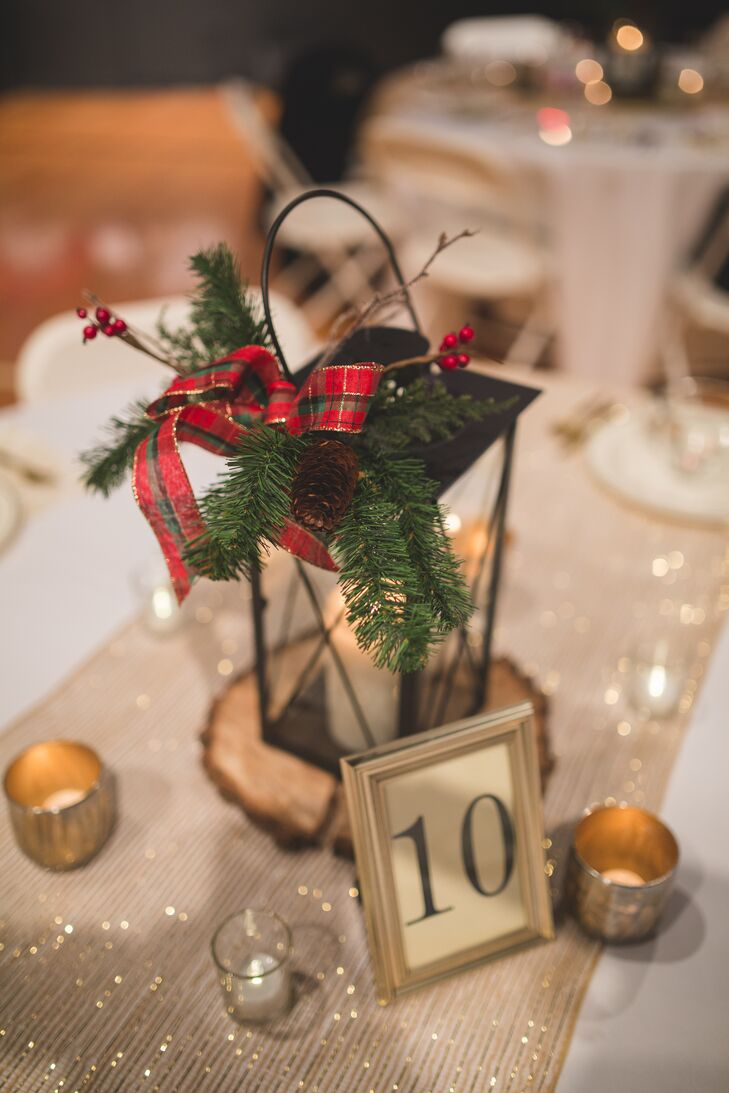 Small gold candles surrounded the black lantern centerpieces and gold-framed table numbers, creating a warm ambience to Elizabeth and Mason's wedding reception.