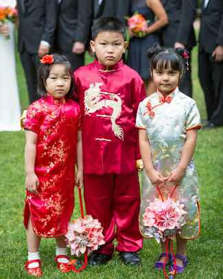 Flower girls and ring bearer wearing traditional Chinese dress