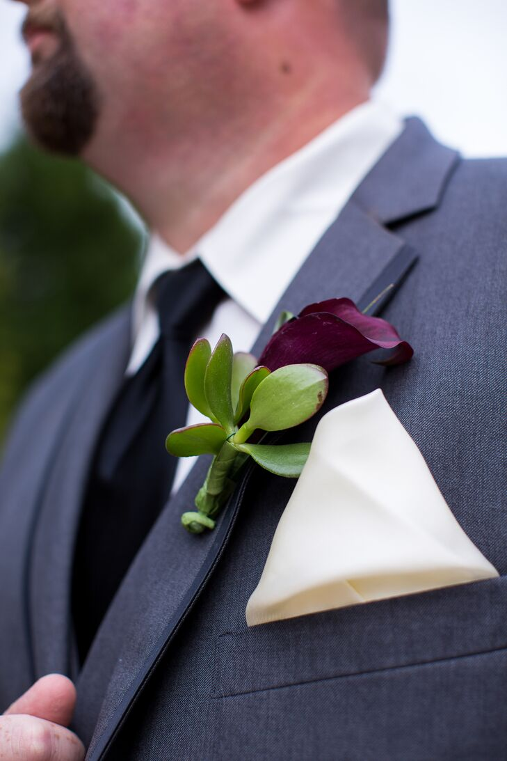 The groom wore a single plum calla flower that was pinned to his tuxedo on the wedding day.