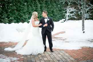 Couple standing surrounded by snow