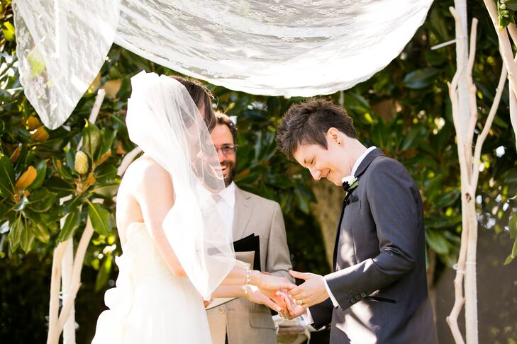 Caitlin wore a Rivini silk organza gown with a medium-length cage-style veil worn at the crown of her head.