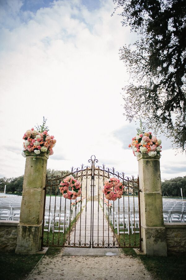 Coral Flower Wreaths on Ceremony Gate
