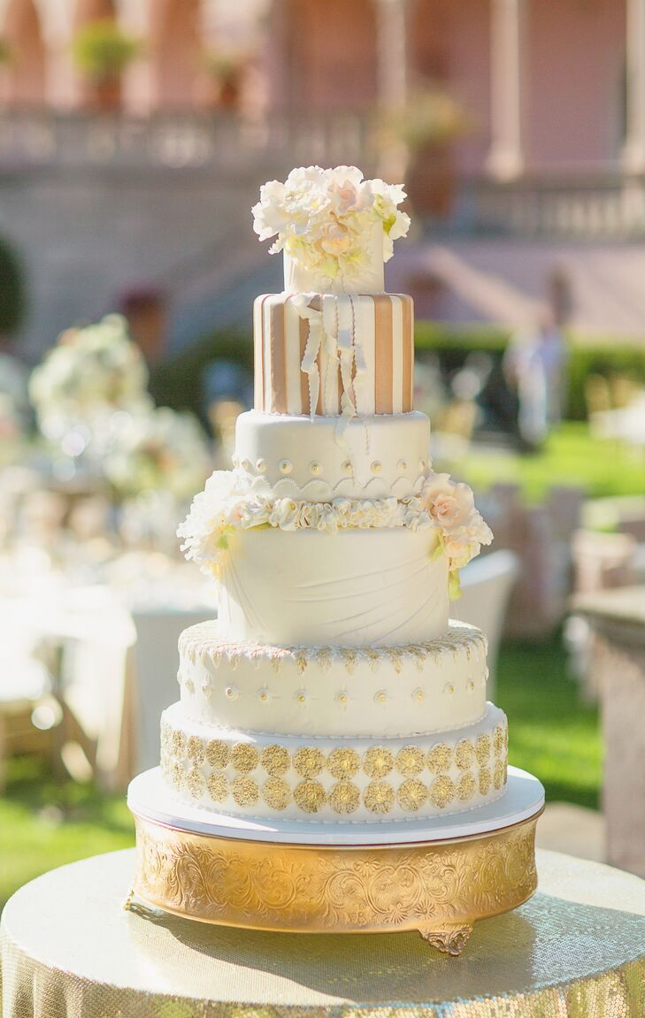 Grand Wedding Cake With Intricate Gold Details
