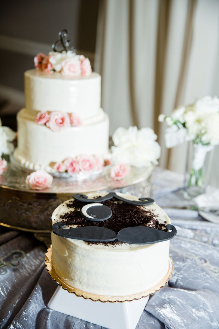 The bride and groom had a traditional two tiered white wedding cake with light pink flowers and an ampersand topper. Next to it they served a had a Natty Boh groom's cake as a tribute to Maryland.