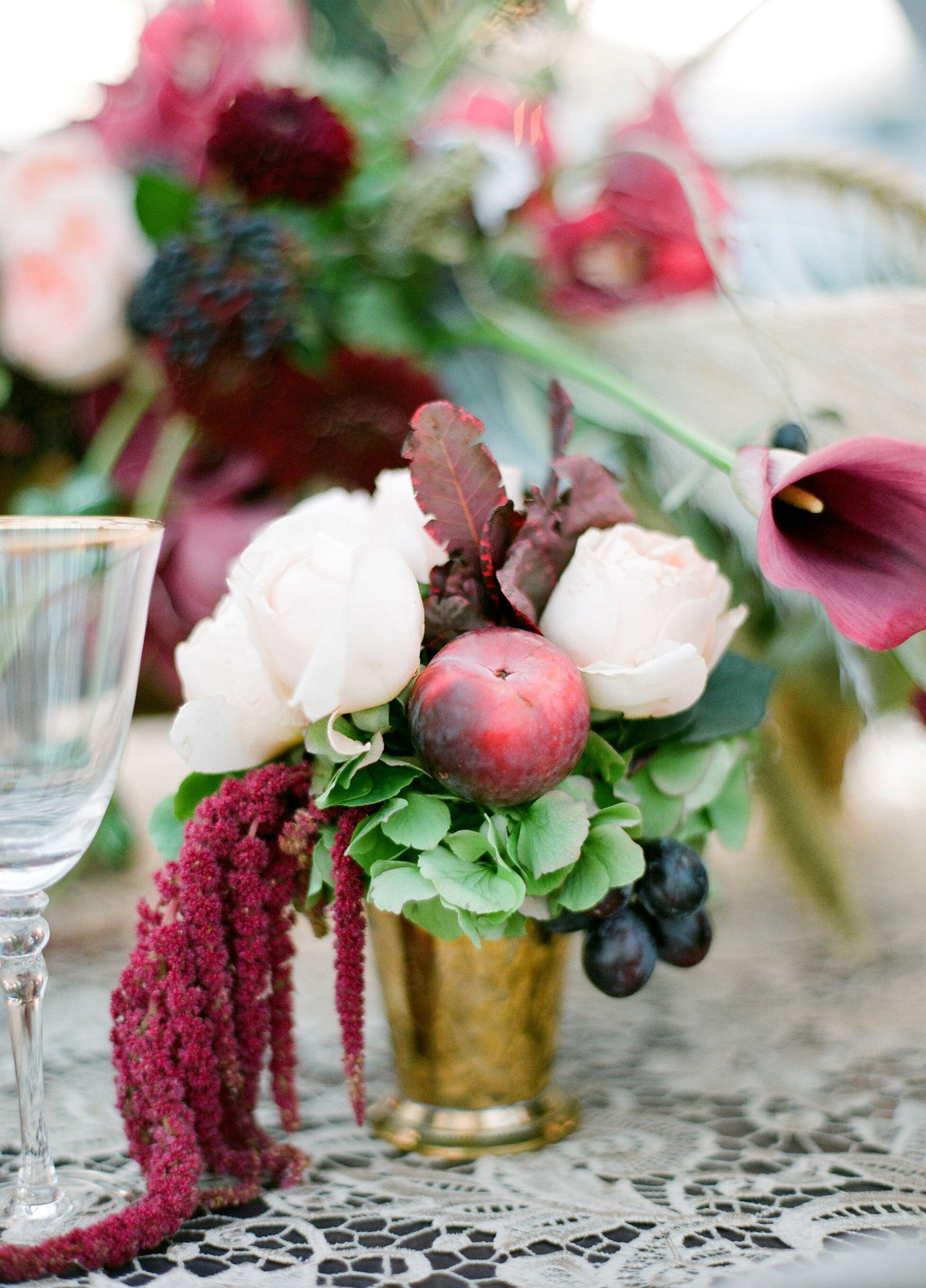 Burgundy amaranthus and fruit centerpiece
