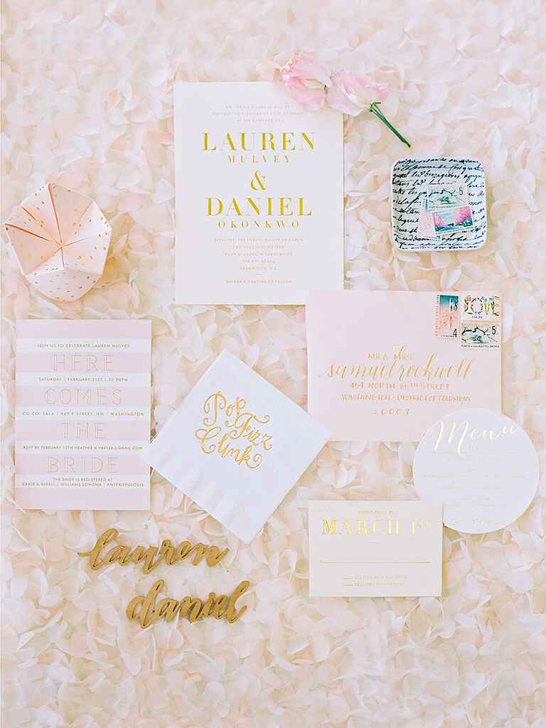 Blush and gold wedding invitations with a cootie catcher