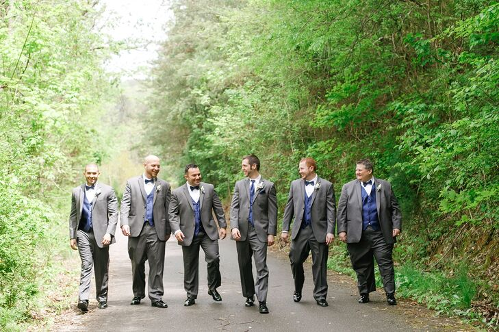 Marc chose a dark gray suit with a blue vest, tie and pocket square and a trio of white flowers in his boutonniere. The groomsmen wore blue bow ties, vests and a single white flower boutonniere.
