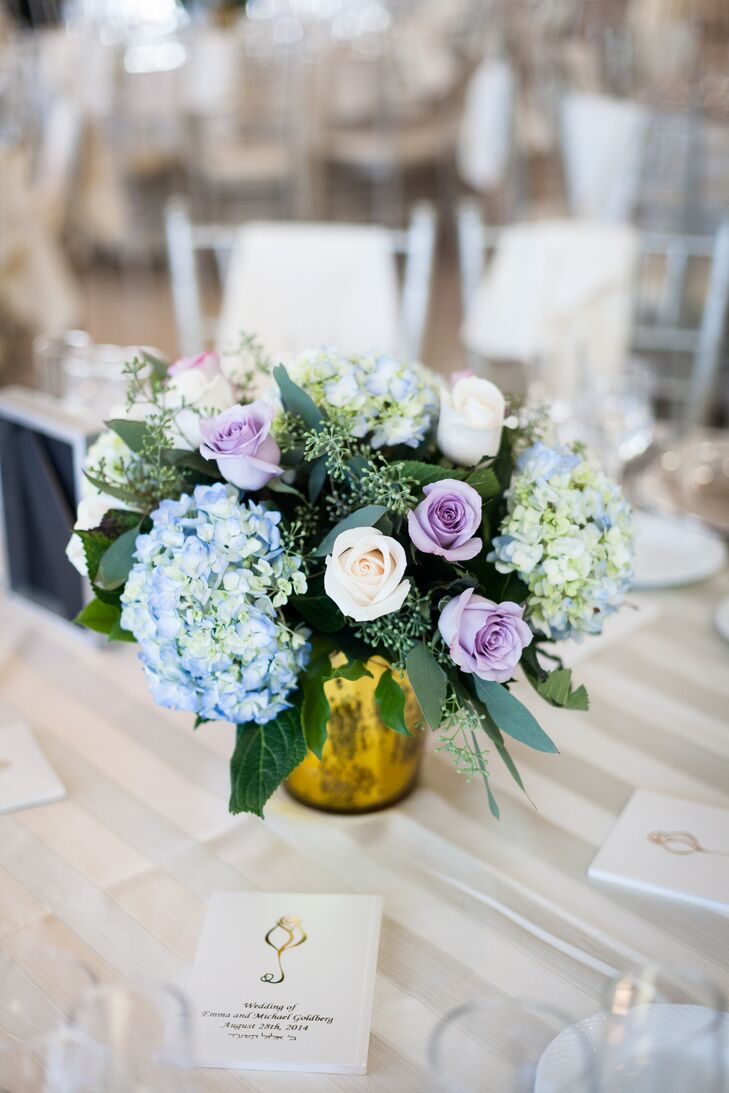 Purple rose and blue hydrangea centerpiece