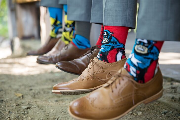 The groomsmen wore fun comic book superhero socks, adding a geeky touch to their light gray Tommy Hilfiger suits.