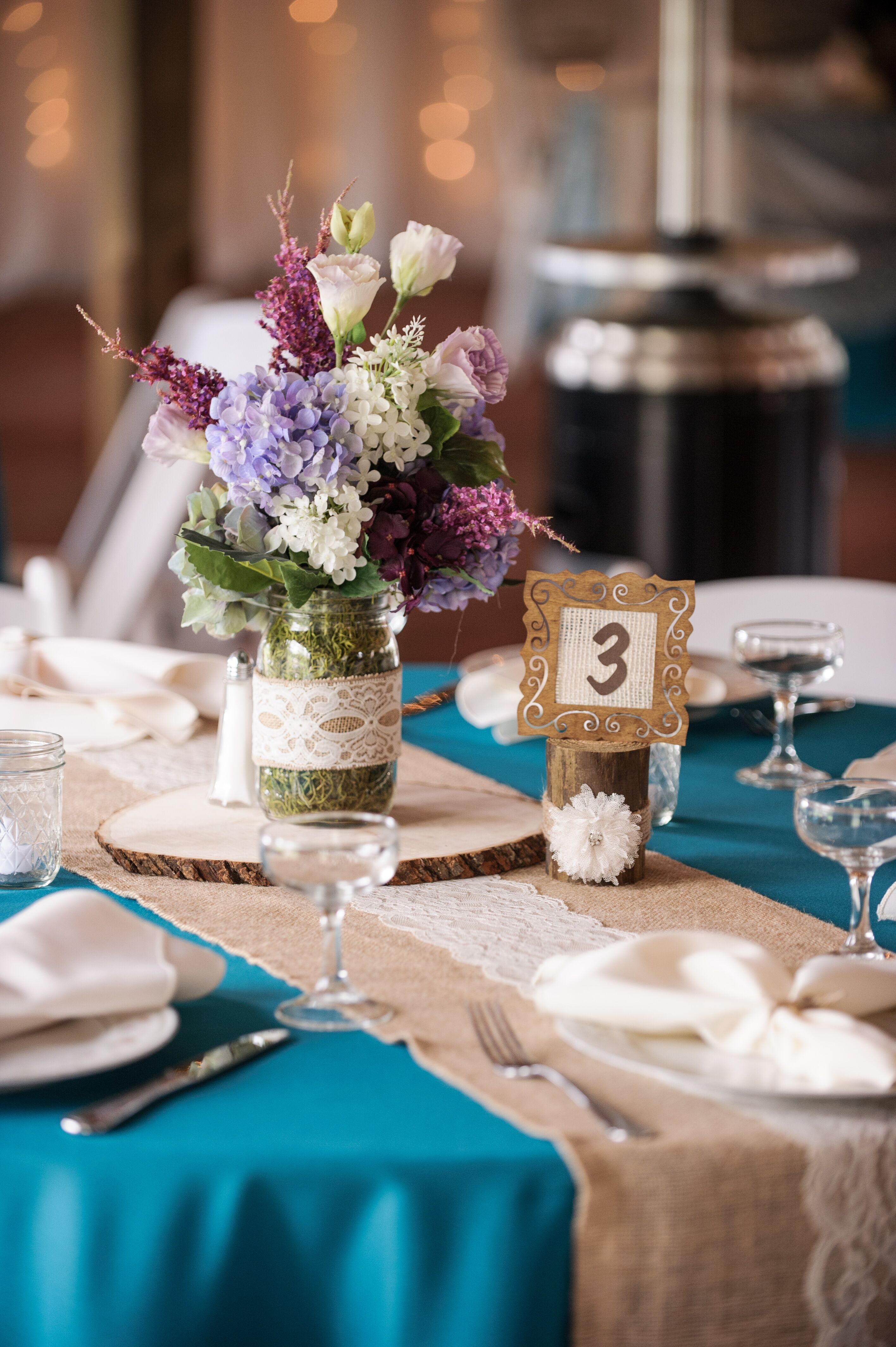 Mason jar centerpiece with purple delphiniums