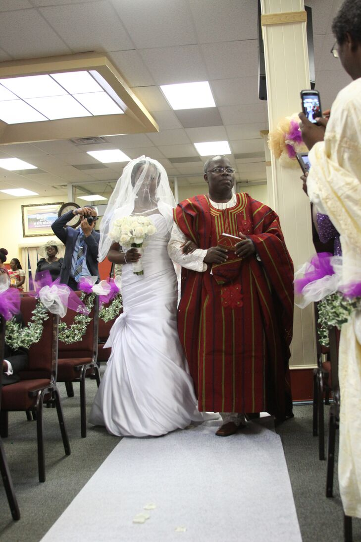 Bride in White Wedding Dress and Father in Nigerian Attire