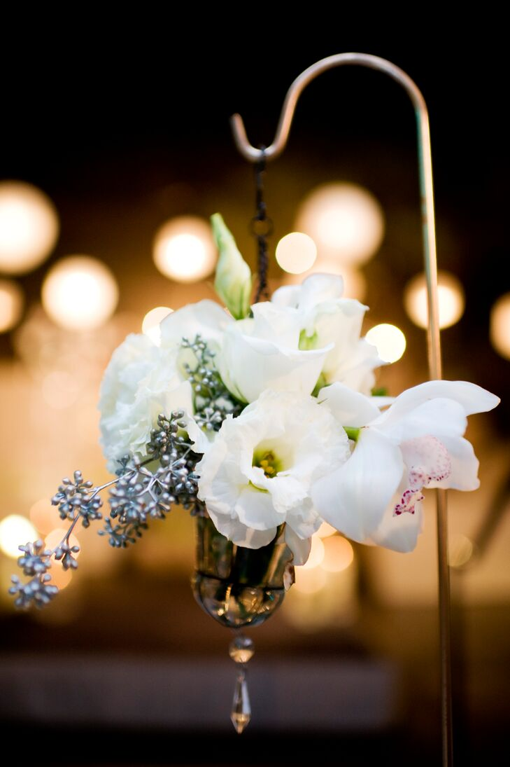 White blooms hung from shepherd's hooks along the aisle.