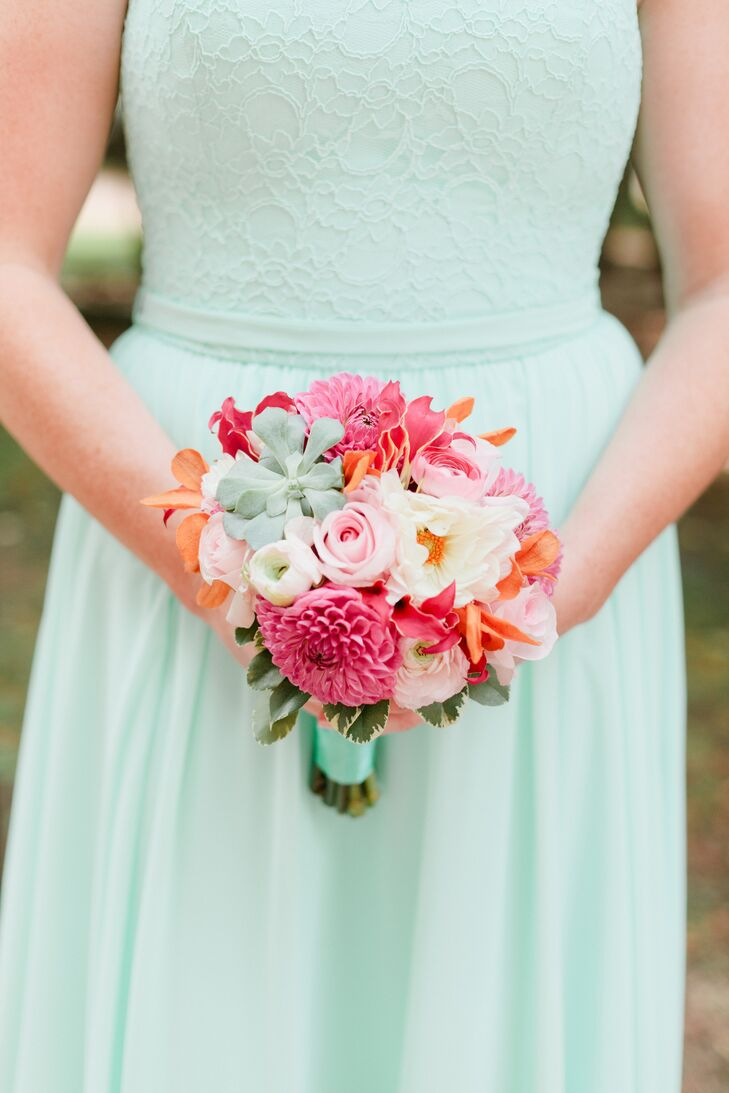 The bridesmaids carried smaller versions of Ali's colorful, textured arrangement. Florals by Claire created the beautiful bouquets including dahlias, succulents, roses, gloriosa lilies and ranunculus. The couple loved how the pink flowers popped against the otherwise mint and gold palette.