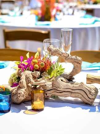 Driftwood centerpiece idea for a destination or beach wedding