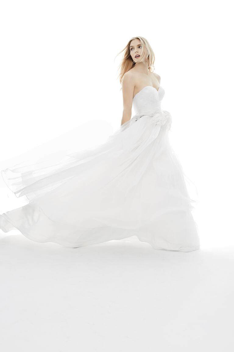 Jim Hjelm wedding dress with an ostrich feather sash