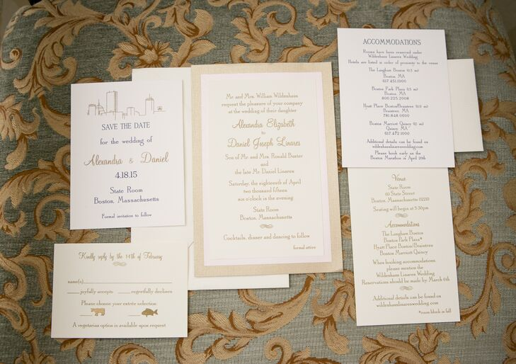 The couple's invitation suite, designed by Allure Invitations, captured the essence of the elegant affair to come with contemporary script in the wedding's gold and navy color scheme and an outline of the Boston skyline.