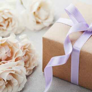 Simple gift box with purple ribbon