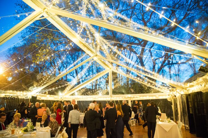 "The reception was held in a 5,000-square-foot clear tent with strings of white lights to illuminate the night. ""Throughout the reception, the sky changed from light blue to a deep dark navy, with the moon and the stars visible from the dance floor,"" Lisa says. ""It was truly magical."""