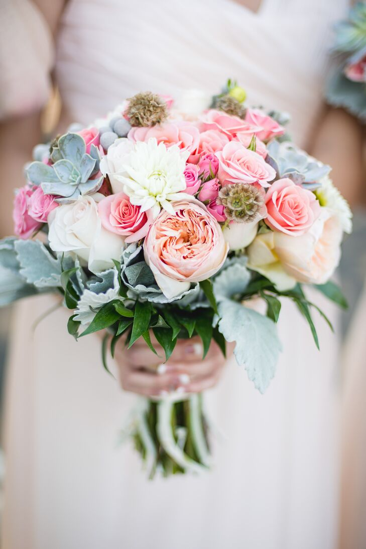 The bridesmaids carried smaller versions of Erin's bouquet, with peach peonies, white dahlias, blush roses, scabiosa pods, dusty miller and succulents.
