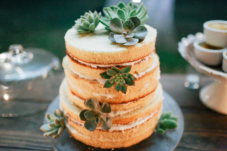 For dessert, Sarah and Charles enjoyed a three-tier naked cake decorated with succulents. Since the couple aren't into cake, they also served Sarah's favorite (chocolate torte) and Charles's favorite (creme brûlée), among other treats.
