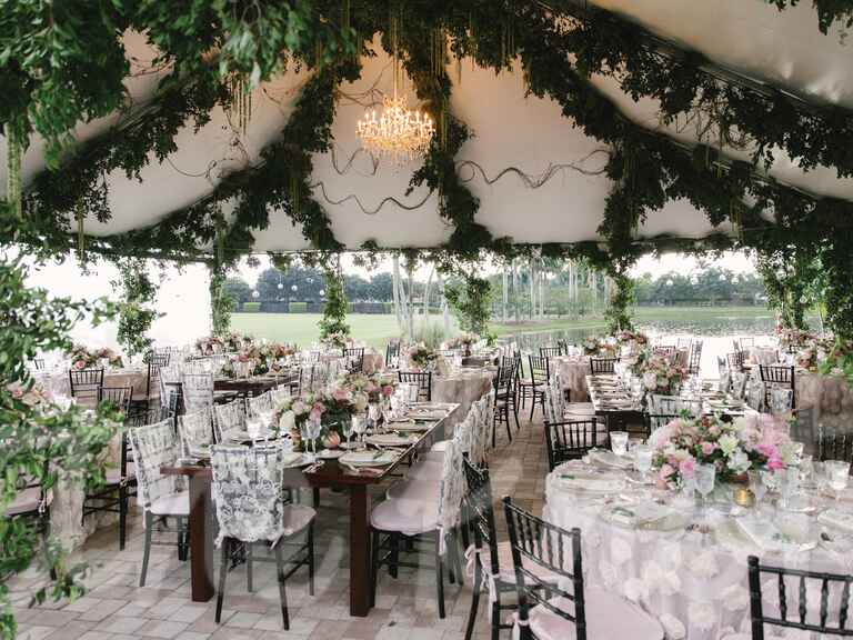 Outdoor tented wedding with green garlands