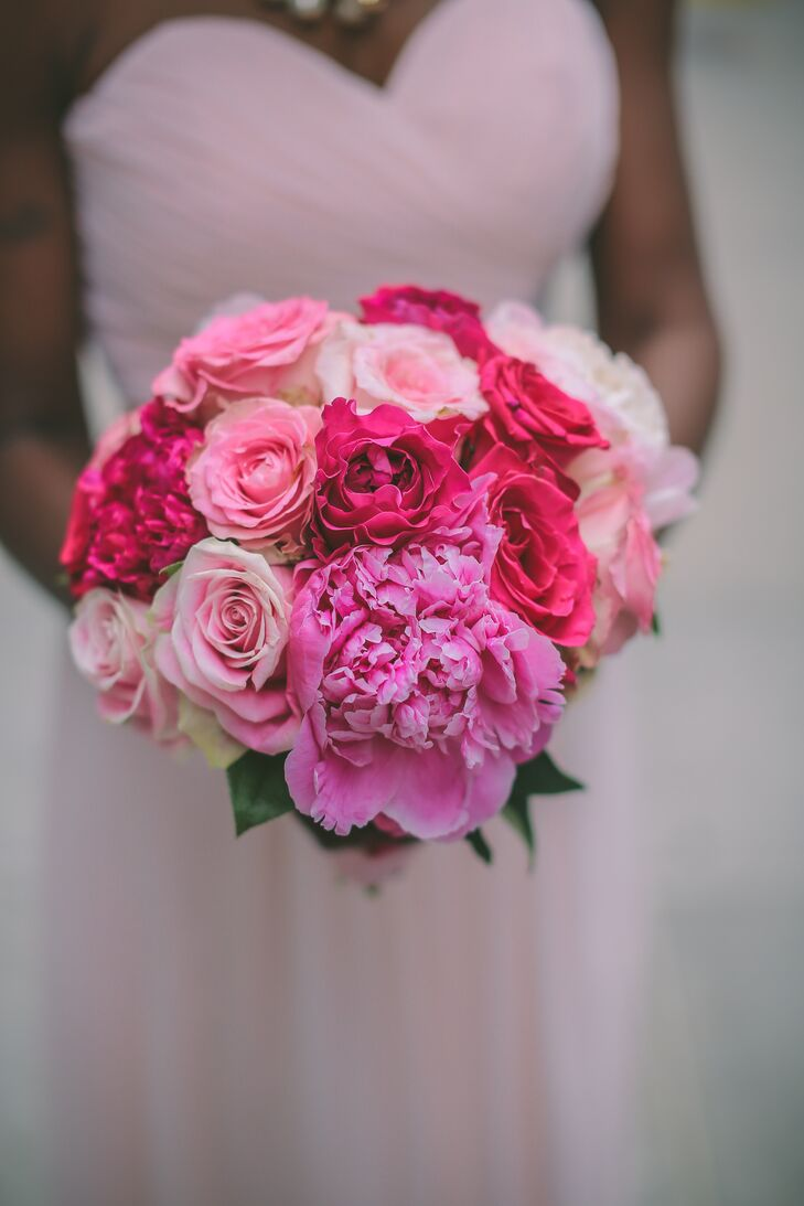 The bride carried a lush bouquet of peonies and roses in pink hues.