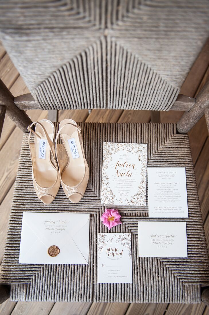 The shoes coordinated with the invitation suite, created by Ashley Buzzy Lettering and Press in Atlanta, Georgia. The design featured floral illustrations and a monogram seal.