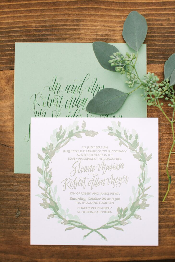 Olive branches and leaves were present throughout Sloane and Robert's wedding day -- in Sloane's floral crown, and all of her floral arrangements as well as on all of her paper goods, including the invitation suite. Sloane says she was inspired by the landscape of the winery.