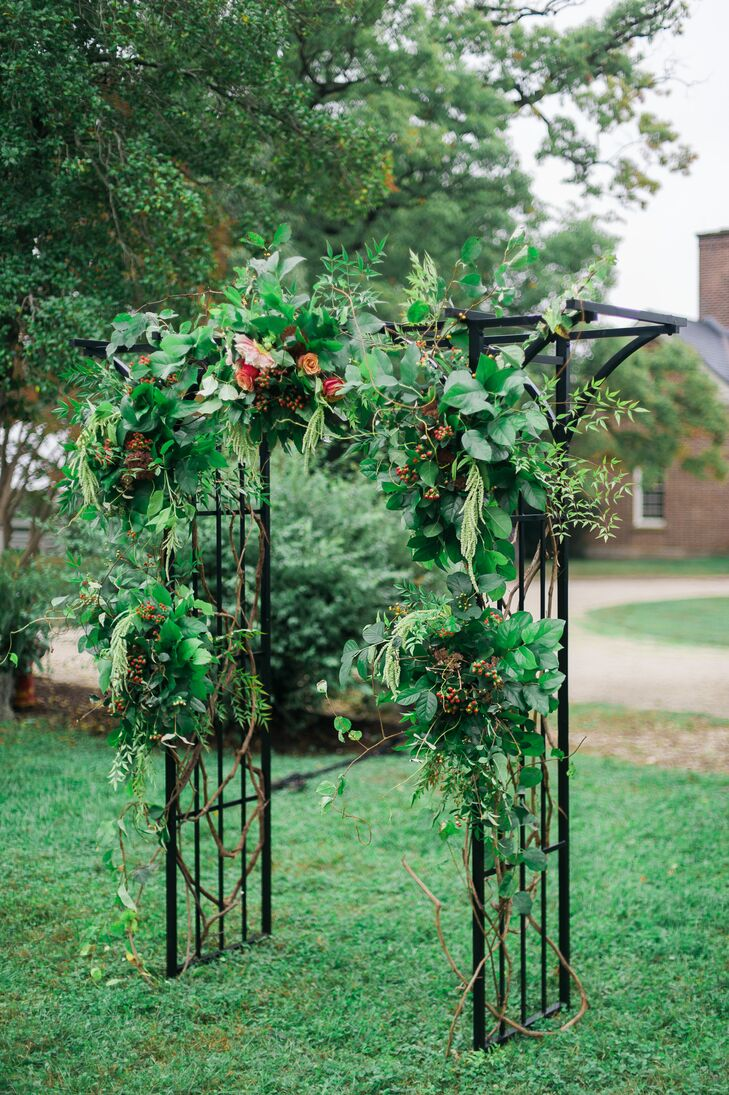 Christine and John got married at the wrought iron arbor in front of Woodlawn in Alexandria, Virginia. The arbor had an abundant amount of vines and curly willow branches, along with roses, dahlias, sedum, amaranthus and berries added to the mix.