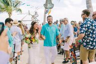 "Color-loving couple Melanie Holliday (32 and a public insurance adjuster) and Andrew Greenburg (32 and a yacht captain) said their ""I dos"" on a privat"