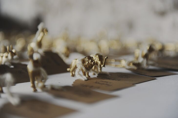 The couple added some golden flair to their escort cards by spray painting tiny, plastic animals.