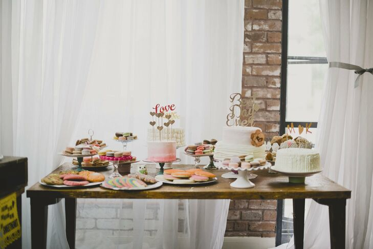 The couple had a total of five cakes and a large assortment of desserts like macarons, cookies and churros.