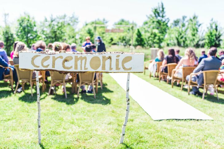 Guests were greeted by a DIY ceremony sign posted on birch wood posts.