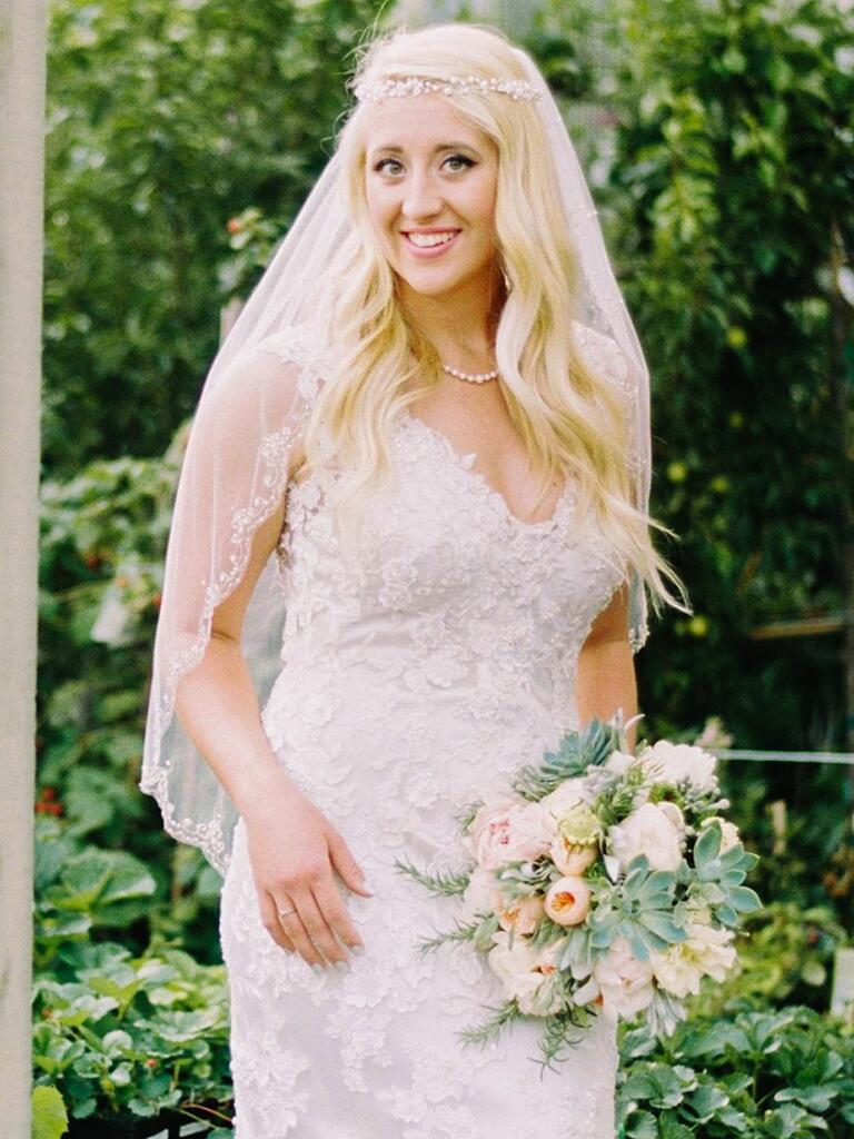 Gold halo crown with embellished flowers and an elbow-length veil