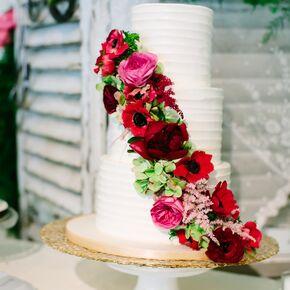 Buttercream Wedding Cake With Rich Pink Floral Cascade