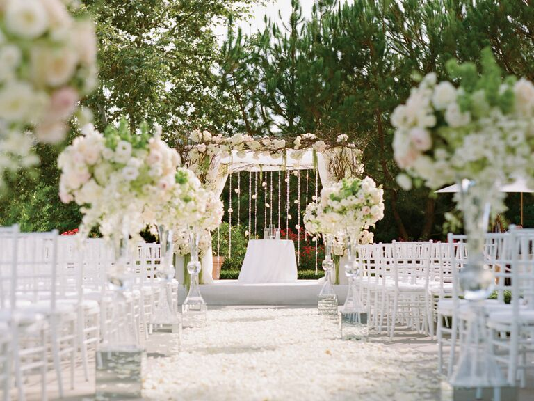 White floral wedding ceremony arch