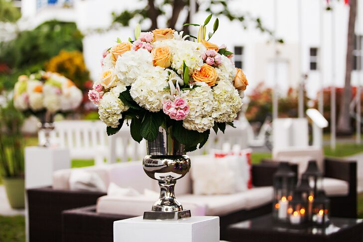 Orange pink and ivory reception flower arrangements mightylinksfo