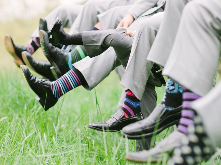 Groomsmen with colorful striped socks